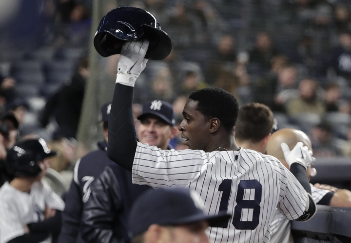 New York Yankees' Didi Gregorius (18) raises his batting helmet to the crowd after hitting a solo home run, his second of the game, against the Miami Marlins during the seventh inning of a baseball game, Monday, April 16, 2018, in New York. (AP Photo/Julie Jacobson)