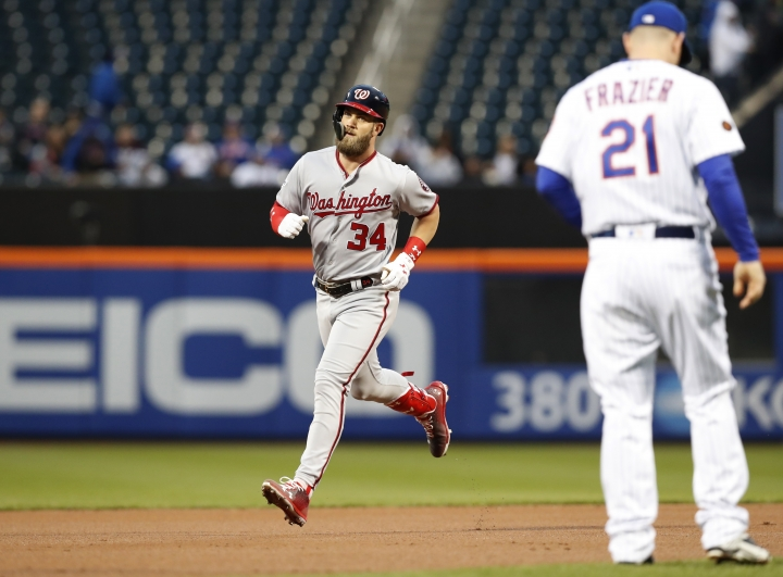 Washington Nationals' Bryce Harper runs the bases past New York Mets third baseman Todd Frazier (21) after hitting a first-inning, solo home run in a baseball game Monday, April 16, 2018, in New York. (AP Photo/Kathy Willens)