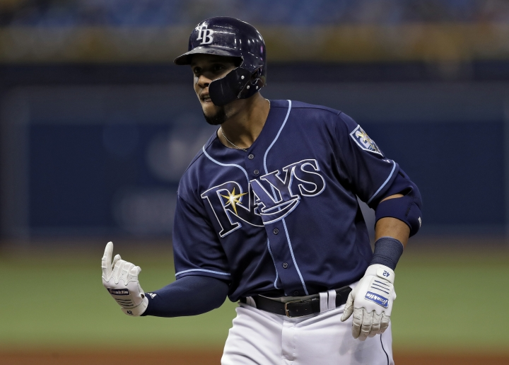 Tampa Bay Rays' Carlos Gomez celebrates after his RBI single off Texas Rangers starting pitcher Martin Perez scored Joey Wendle during the second inning of a baseball game Monday, April 16, 2018, in St. Petersburg, Fla. (AP Photo/Chris O'Meara)