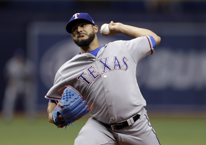Texas Rangers starting pitcher Martin Perez delivers to the Tampa Bay Rays during the first inning of a baseball game Monday, April 16, 2018, in St. Petersburg, Fla. (AP Photo/Chris O'Meara)
