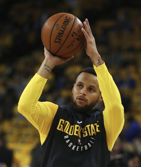 Golden State Warriors' Stephen Curry warms up prior to Game 2 of a first-round NBA basketball playoff series against the the San Antonio Spurs, Monday, April 16, 2018, in Oakland, Calif. (AP Photo/Ben Margot)