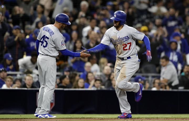 Los Angeles Dodgers' Matt Kemp, right, is greeted by third base coach Chris Woodward (45) after hitting a three-run home run during the third inning of a baseball game against the San Diego Padres Monday, April 16, 2018, in San Diego. (AP Photo/Gregory Bull)