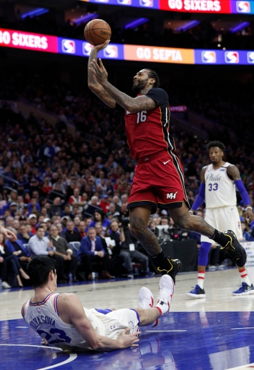 Miami Heat's James Johnson, right, shoots and draws the foul call on Philadelphia 76ers' Ersan Ilyasova, left, of Turkey, during the first half in Game 2 of a first-round NBA basketball playoff series, Monday, April 16, 2018, in Philadelphia. (AP Photo/Chris Szagola)