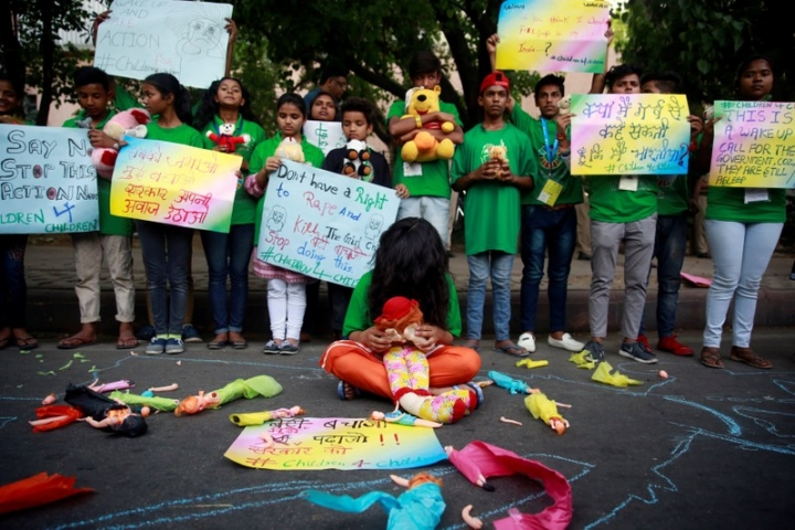 Children take part in a protest against the rape of an eight-year-old girl, in Kathua, near Jammu and a teenager in Unnao, Uttar Pradesh state, in New Delhi, India April 15, 2018. REUTERS/Cathal McNaughton