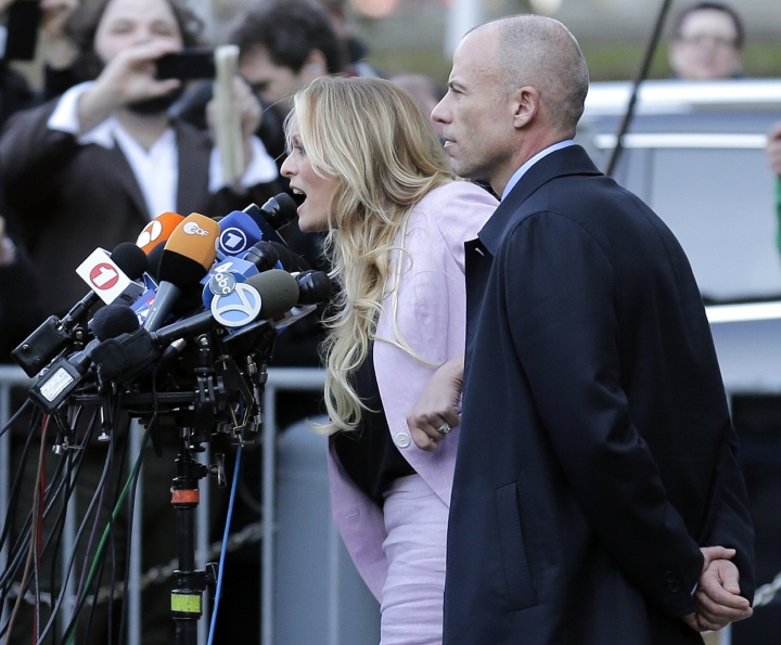 Adult film actress Stormy Daniels, left, speaks as her lawyer Michael Avenatti listens outside federal court, Monday, April 16, 2018, in New York. (AP Photo/Seth Wenig)