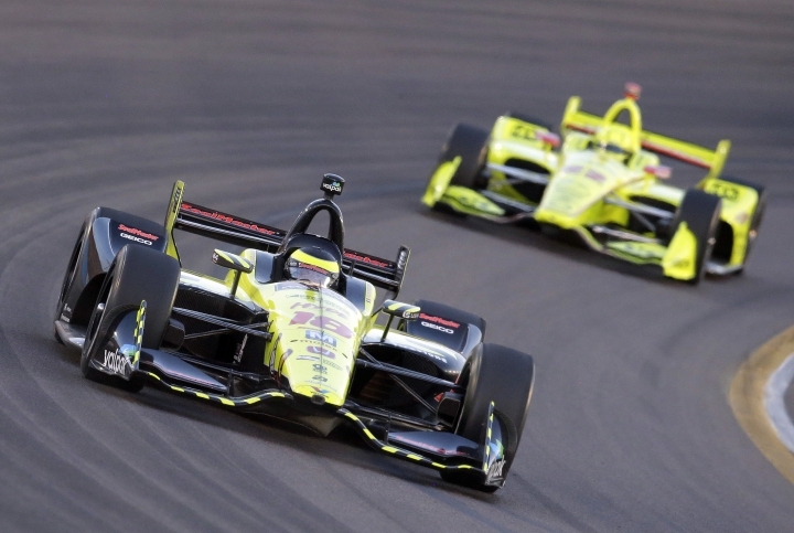 Sebastian Bourdais (18) leads Simon Pagenaud on the 15th lap during the IndyCar auto race Saturday, April 7, 2018, at Phoenix International Raceway in Avondale, Ariz. (AP Photo/Rick Scuteri)