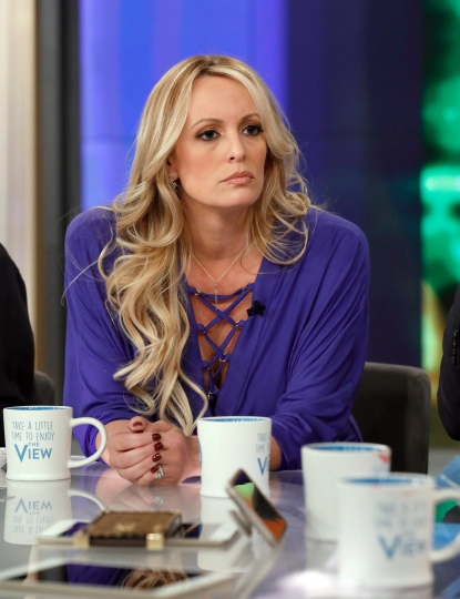 "This image released by ABC shows adult film actress Stormy Daniels during an appearance on the daytime talk show ""The View,"" Tuesday, April 17, 2018, in New York. Daniels released a composite sketch Tuesday of the man she says threatened her in a Las Vegas parking lot to stay quiet about her past sexual tryst with President Donald Trump. (Heidi Gutman/ABC via AP)"