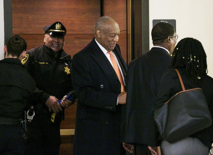 Actor and comedian Bill Cosby, center, arrives Tuesday, April 17, 2018, during his sexual assault retrial at the Montgomery County Courthouse, in Norristown, Pa. (Jessica Griffin/The Philadelphia Inquirer via AP, Pool)