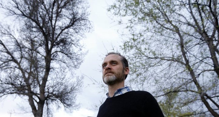 Nathan Frodsham, who suffers from cervical arthritis and disc disease, poses for a photograph at his home, Monday, April 16, 2018, in Murray, Utah. Voters in Utah this November will consider a ballot initiative that would legalize medical marijuana for people with certain chronic conditions. (AP Photo/Rick Bowmer)
