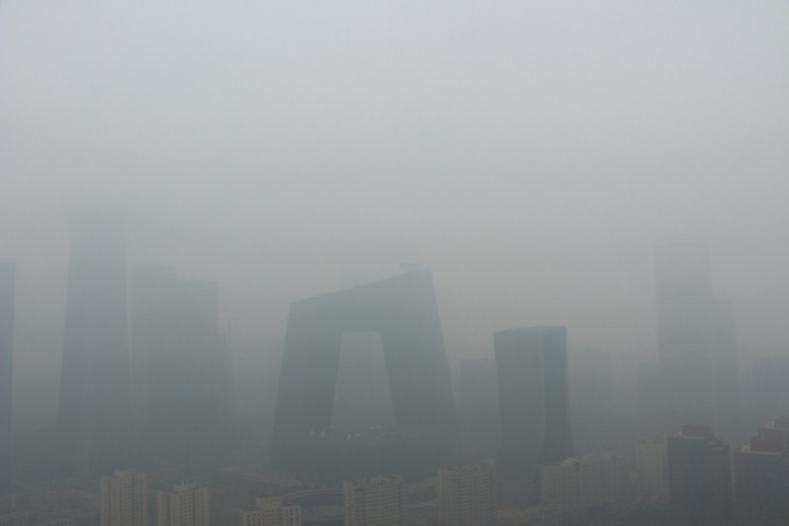 Buildings are seen amid smog on a polluted day where a blue alert is issued, in Beijing, China April 2, 2018. REUTERS/Stringer