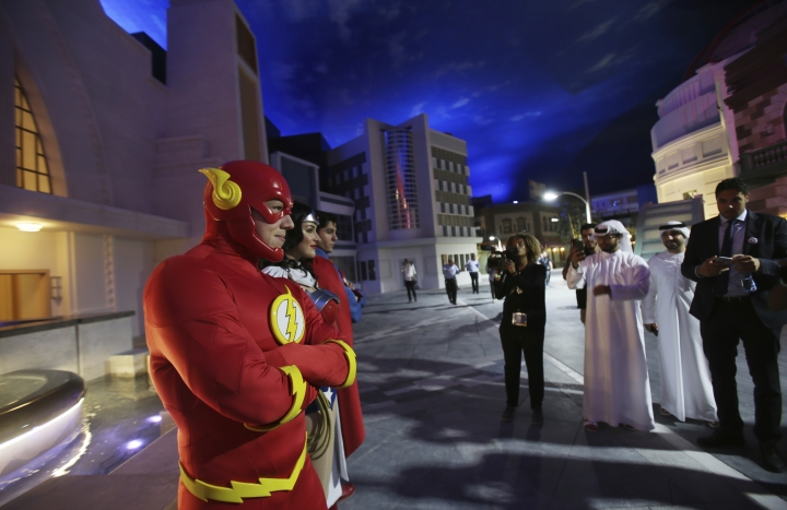The Flash, Wonder Woman and Superman characters pose for picture at the Warner Bros. World amusement park in Abu Dhabi, United Arab Emirates, Wednesday, April 18, 2018. Abu Dhabi will open a $1 billion indoor Warner Bros. amusement park this July, officials announced Wednesday, the latest offering in a crowded market in the United Arab Emirates where one marquee park already faces serious financial problems. (AP Photo/Kamran Jebreili)