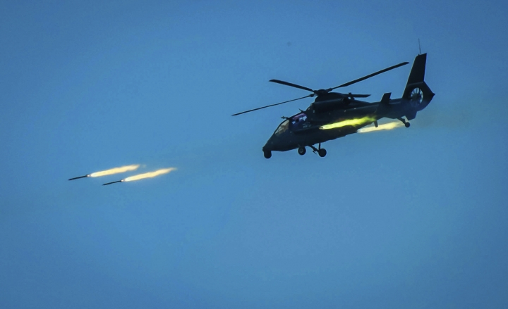 CORRECTS DATE IN SECOND SENTENCE - In this April 18, 2018, photo provided by China's Xinhua News Agency, a Chinese armed helicopter assaults targets with rocket projectiles in a live-fire exercise off China's southeast coast. Taiwan's government said Thursday, April 19, 2018, recent Chinese military drills are aimed at intimidating the island and are a threat to regional peace and stability. The Mainland Affairs Council said there would be no giving in or making of concessions to Beijing and that the situation was being closely monitored. China held live-fire exercises involving attack helicopters off its southeast coast on Wednesday. (Li Shilong/Xinhua News Agency via AP)