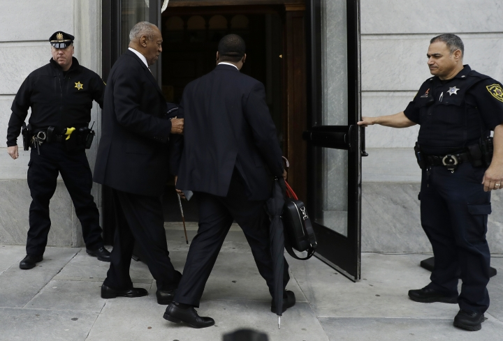 Bill Cosby, second from left, arrives for his sexual assault trial, Thursday, April 19, 2018, at the Montgomery County Courthouse in Norristown, Pa. (AP Photo/Matt Slocum)