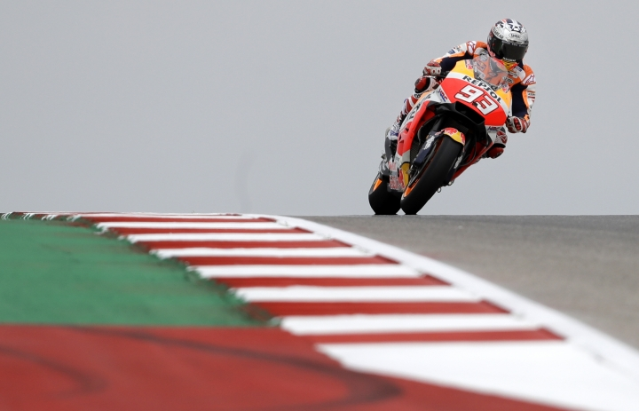 Marc Marquez (93) of Spain navigates through a turn during a warm up session for the Grand Prix of the Americas MotoGP motorcycle race at the Circuit Of The Americas in Austin, Texas, Friday, April, 20, 2018. (AP Photo/Eric Gay)