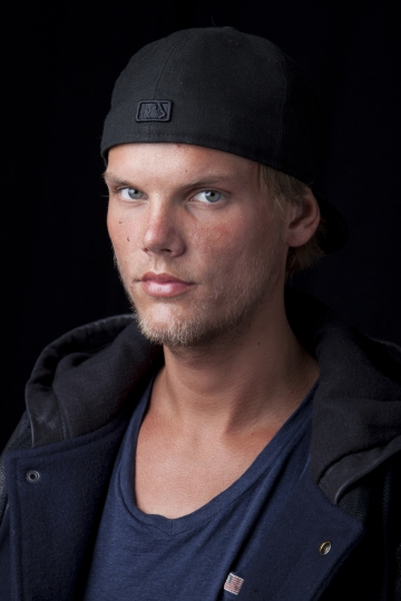 FILE - In this Aug. 30, 2013 file photo, Swedish DJ-producer, Avicii poses for a portrait, in New York. Swedish-born Avicii, whose name is Tim Bergling, was found dead, Friday April 20, 2018, in Muscat, Oman. He was 28. (Photo by Amy Sussman/Invision/AP, File)