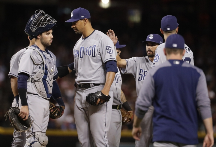 San Diego Padres starting pitcher Tyson Ross, center, is greeted by catcher Austin Hedges, left, and teammates as he is about to be pulled from the baseball game during the eighth inning against the Arizona Diamondbacks Friday, April 20, 2018, in Phoenix. (AP Photo/Matt York)