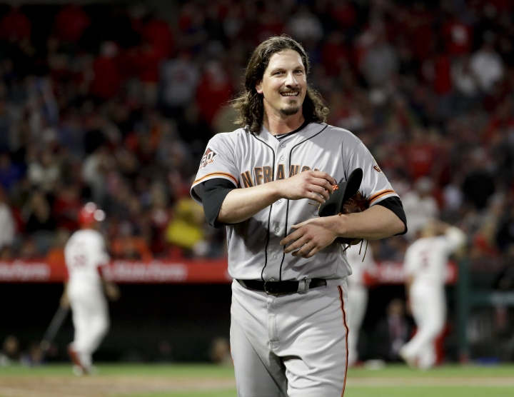 San Francisco Giants starting pitcher Jeff Samardzija smiles after Los Angeles Angels' Justin Upton flied out with the bases loaded to end the fifth inning of a baseball game in Anaheim, Calif., Friday, April 20, 2018. (AP Photo/Chris Carlson)
