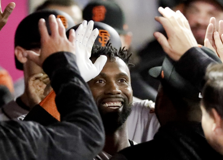 San Francisco Giants' Andrew McCutchen celebrates in the dugout after his three-run home run against the Los Angeles Angels during the fifth inning of a baseball game in Anaheim, Calif., Friday, April 20, 2018. (AP Photo/Chris Carlson)