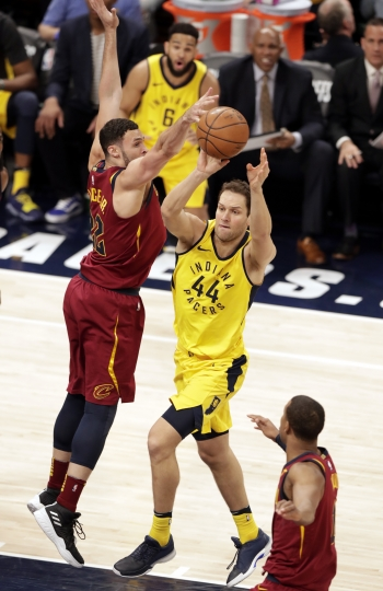 Indiana Pacers forward Bojan Bogdanovic (44) makes a pass in front of Cleveland Cavaliers forward Larry Nance Jr. (22) during the first half of Game 3 of an NBA basketball first-round playoff series in Indianapolis, Friday, April 20, 2018. (AP Photo/Michael Conroy)