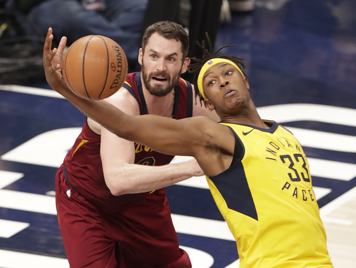 Indiana Pacers center Myles Turner (33) grabs a rebound in front of Cleveland Cavaliers' Kevin Love during the first half of Game 3 of an NBA basketball first-round playoff series in Indianapolis, Friday, April 20, 2018. (AP Photo/Michael Conroy)
