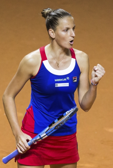 Czech Republic's Karolina Pliskova celebrates a point in her match with Germany's Angelique Kerber, at the tennis Fed Cup semifinal between Germany and Czech Republic in Stuttgart, Germany, Saturday, April 21, 2018. (Thomas Niedermueller/dpa via AP)