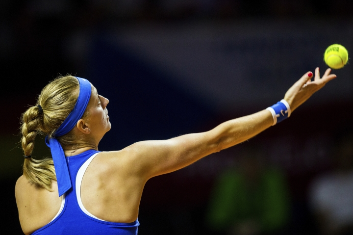 Czech Republic's Petra Kvitova serves a ball to Julia Goerges during a single match of the tennis Fed Cup semifinal between Germany and Czech Republic in Stuttgart, Germany, Saturday, April 21, 2018. (Thomas Niedermueller/dpa via AP)