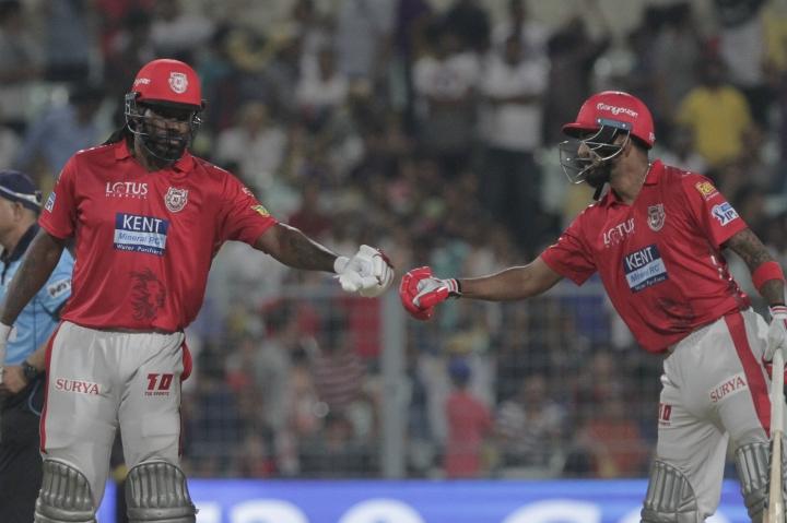 Lokesh Rahul, right, congratulates teammate Chris Gayle for scoring fifty runs against Kolkata Knight Riders during VIVO IPL cricket T20 match in Kolkata, India, Saturday, April 21, 2018. (AP Photo/Bikas Das)