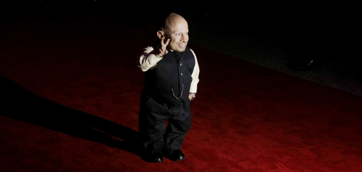 "File-This Oct. 6, 2009, file photo shows cast member Verne Troyer posing for photographs as he arrives at the gala premiere of the film ""The Imaginarium of Doctor Parnassus"" at a cinema in London. Troyer from the ""Austin Powers"" movie franchise has died. A statement provided by Troyer's representatives that was also posted to his Instagram and Facebook accounts says the 49-year-old actor died Saturday, April 21, 2018. No cause or place of death was given, but the statement discusses depression and suicide, and Troyer had publicly discussed struggling with alcohol addiction. He lived in Los Angeles. (AP Photo/Matt Dunham, File)"