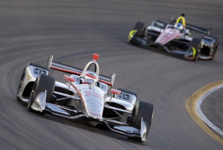 Will Power (12), of Australia, drives through a turn in the early laps of the IndyCar auto race Saturday, April 7, 2018, at Phoenix International Raceway in Avondale, Ariz. (AP Photo/Rick Scuteri)