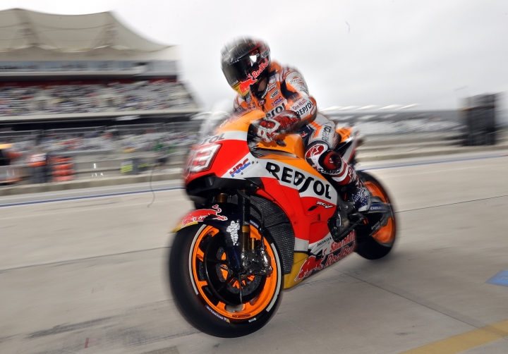 Marc Marquez (93) of Spain pulls into his garage assignment during a free practice for the Grand Prix of the Americas motorcycle race at the Circuit of the Americas in Austin, Texas, Saturday, April 21, 2018. (AP Photo/Eric Gay)