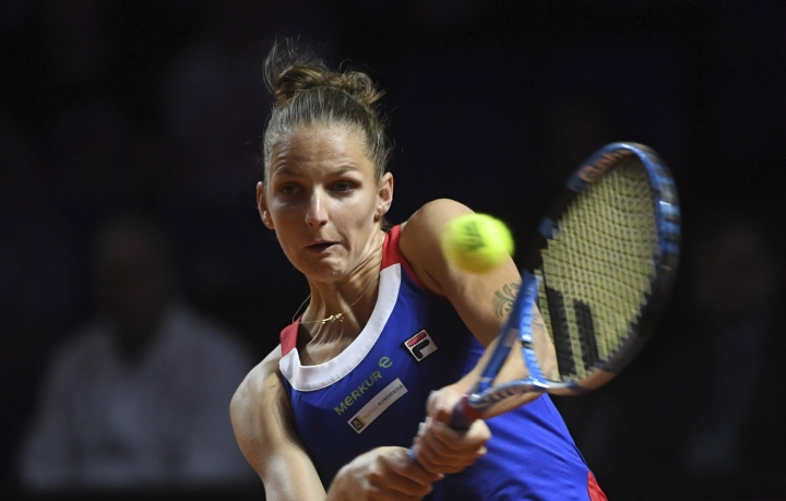 Czech Republic's Karolina Pliskova returns a shot to Germany's Julia Goerges during the tennis Fed Cup semifinal, in Stuttgart, Germany, Sunday, April 22, 2018. (Marijan Murat/dpa via AP)