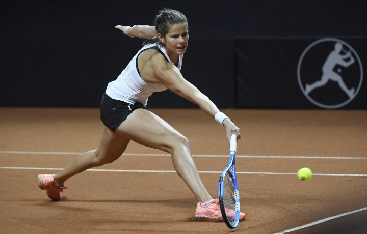 Germany's Julia Goerges returns a shot to Czech Republic's Karolina Pliskova during a match of the tennis Fed Cup semifinal between Germany and Czech Republic, in Stuttgart, Germany, Sunday, April 22, 2018. (Marijan Murat/dpa via AP)