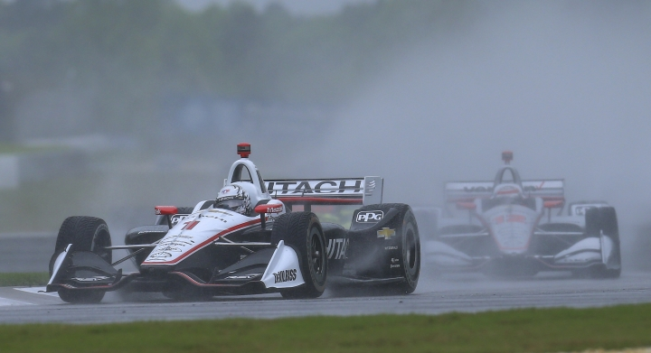 IndyCar driver Josef Newgarden (1) kicks up a water spray as he leads Will Power of Australia (12) out of a turn during the Honda Indy Grand Prix of Alabama at Barber Motorsports Park, Sunday, April 22, 2018, in Birmingham, Ala. (AP Photo/Butch Dill)