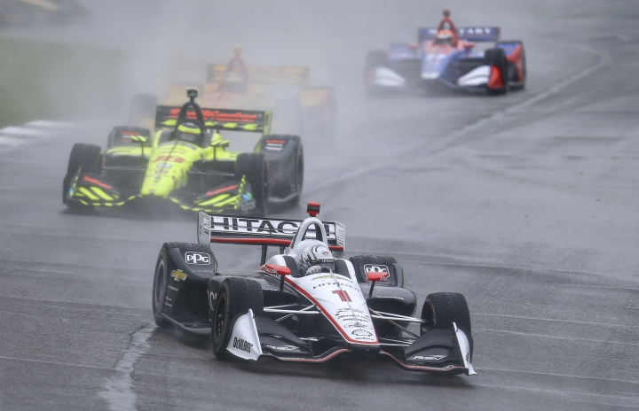 IndyCar driver Josef Newgarden (1) leads a pack of cars during the Honda Indy Grand Prix of Alabama auto race at Barber Motorsports Park, Sunday, April 22, 2018, in Birmingham, Ala. Race is postponed until Monday due to weather. (AP Photo/Butch Dill)
