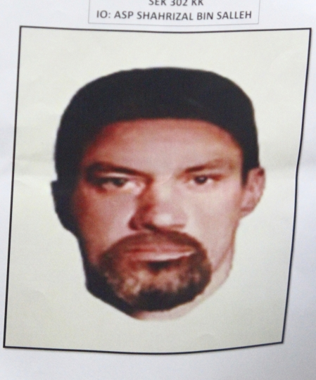 A composite image of a suspect of killing of a Palestinian man is shown by Malaysian national police during a press conference in Kuala Lumpur, Malaysia, Monday, April 23, 2018. Malaysian police released Monday composite images of two suspects who gunned down 34-year-old Palestinian engineer Fadi al-Batsh and are stepping up efforts to track them. Gaza's ruling Hamas militant group accused Israel of being behind Saturday's killing of al-Batsh, an important member of Hamas. (AP Photo)