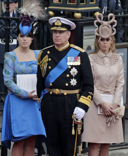"FILE - In this April, 29, 2011 file photo, Britain's Prince Andrew, center, and his daughters Britain's Princess Eugenie, left, and Britain's Princess Beatrice leave Westminster Abbey at the Royal Wedding of Prince William and Kate Middleton in London. The wedding of Prince Harry and Meghan Markle on May 19 comes with a world of etiquette and protocol for guests. While the upper crust among them may be well initiated, newbies from Hollywood could be attending their first royal affair. The invitations to 600 guests described the high church dress code thusly: For men, military uniforms, morning coats or lounge suits, otherwise known as business suits in not-wacky colors. For women, ""day dress with hat."" (AP Photo/Gero Breloer, File)"