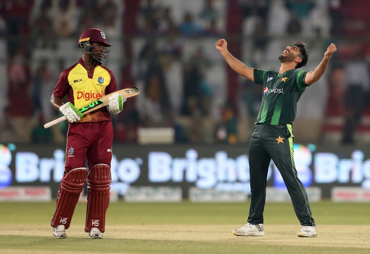 "FILE - In this Monday, April 2, 2018 file photo, Pakistani bowler Mohammad Amir, right, celebrates the dismissal of West Indies captain Jason Mohammed in Karachi, Pakistan. Amir's departure for the tours of Ireland and England has been delayed due to delay in obtaining his visa. ""Amir could not travel with the team,"" the Pakistan Cricket Board spokesman Amjad Bhatti confirmed to the AP. (AP Photo/Shakil Adil, file)"
