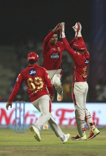 Kings XI Punjab's Mujeeb Ur Rahman, center, celebrates the wicket of Delhi Daredevils's Rishabh Pant during the VIVO IPL Twenty20 cricket match in New Delhi, India, Monday, April 23, 2018. (AP Photo/Manish Swarup)