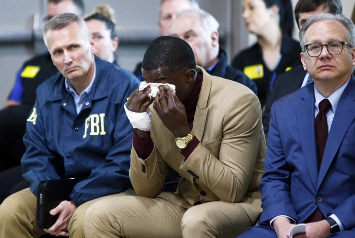 Hero James Shaw wipes tears away during a press conference on the Waffle House shooting Sunday, April 22, 2018 in Nashville, Tenn. Shaw wrestled the gun from the suspect. To Shaw's right is Nashville Metro Mayor David Briley and to his left is FBI Special Agent in Charge Matthew Espenshade. (Wade Payn/The Tennessean via AP)