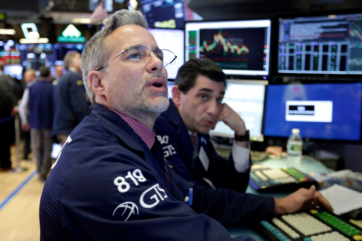 Specialists Anthony Rinaldi, left, and Peter Mazza work on the floor of the New York Stock Exchange, Monday, April 23, 2018. U.S. stocks are mixed Monday morning as health care and industrial companies make gains and energy companies slip with oil prices. (AP Photo/Richard Drew)