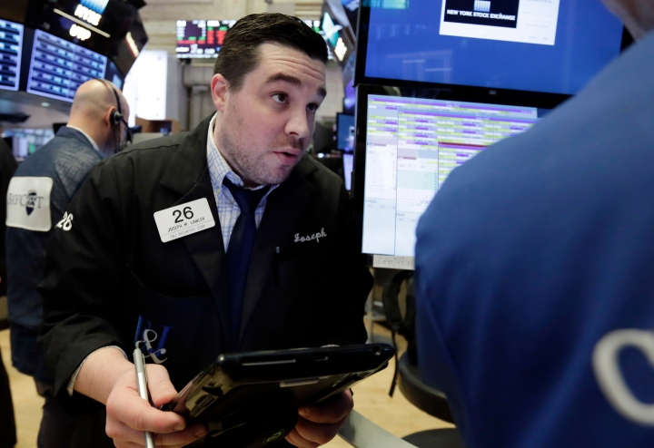 Trader Joseph Lawler works on the floor of the New York Stock Exchange, Monday, April 23, 2018. U.S. stocks are mixed Monday morning as health care and industrial companies make gains and energy companies slip with oil prices. (AP Photo/Richard Drew)