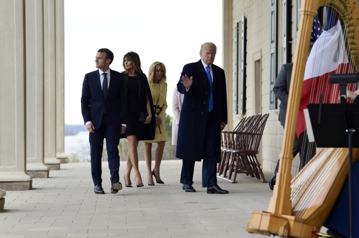 President Donald Trump, right, waves as he walks with French President Emmanuel Macron, left, first lady Melania Trump, second from left, and Brigitte Macron, second from right, during a visit and private dinner at George Washington's Mount Vernon estate in Mount Vernon, Va., Monday, April 23, 2018. (AP Photo/Susan Walsh)
