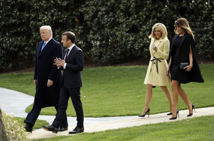 President Donald Trump and first lady Melania Trump walk on the South Lawn with French President Emmanuel Macron and his wife Brigitte Macron at the White House, Monday, April 23, 2018, in Washington. (AP Photo/Evan Vucci)