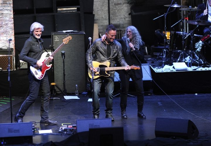 """Bruce Springsteen, center, and Patti Smith, right, perform after a special screening of """"Horses: Patti Smith and Her Band"""" at the Beacon Theatre during the 2018 Tribeca Film Festival, on Monday, April 23, 2018, in New York. (Photo by Brad Barket/Invision/AP)"""