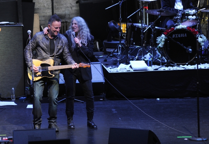 """Bruce Springsteen, left, and Patti Smith perform after a special screening of """"Horses: Patti Smith and Her Band"""" at the Beacon Theatre during the 2018 Tribeca Film Festival, on Monday, April 23, 2018, in New York. (Photo by Brad Barket/Invision/AP)"""