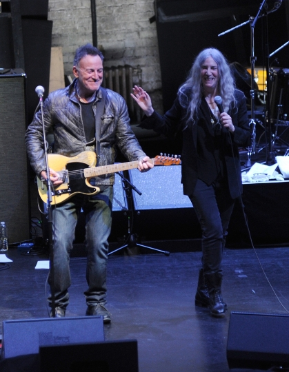 "Bruce Springsteen, left, and Patti Smith perform after a special screening of ""Horses: Patti Smith and Her Band"" at the Beacon Theatre during the 2018 Tribeca Film Festival, on Monday, April 23, 2018, in New York. (Photo by Brad Barket/Invision/AP)"