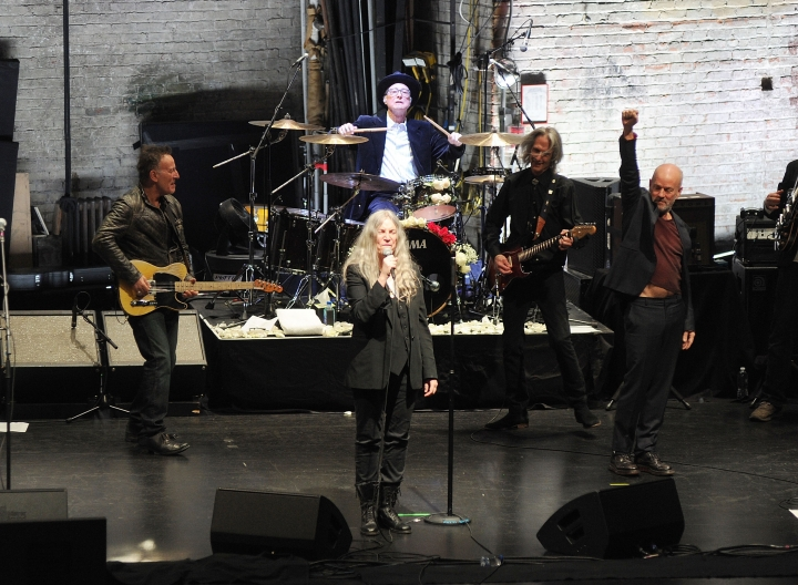 "Bruce Springsteen, left, Patti Smith, center, and Michael Stipe perform after a special screening of ""Horses: Patti Smith and Her Band"" at the Beacon Theatre during the 2018 Tribeca Film Festival, on Monday, April 23, 2018, in New York. (Photo by Brad Barket/Invision/AP)"