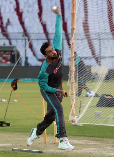 """FILE - In this Saturday, March 31, 2018 file photo, Pakistan cricketer Mohammad Amir bowls during a net practice sessionin Karachi, Pakistan. Amir's departure for the tours of Ireland and England has been delayed due to delay in obtaining his visa. """"Amir could not travel with the team,"""" the Pakistan Cricket Board spokesman Amjad Bhatti confirmed to the AP. (AP Photo/Shakil Adil, File)"""