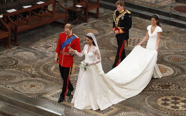 FILE - In this Friday, April 29, 2011 file photo, Britain's Prince William, foreground left, and his wife Kate, the Duchess of Cambridge, foreground right, during their wedding service at Westminster Abbey in London. With less than a month to go till she marries Prince Harry at Windsor Castle on May 19, Meghan Markle would most likely have chosen her wedding dress - though what it looks like is expected to remain a top secret until the last minute. Princess Diana's 1981 wedding gown, with its puff sleeves, romantic ruffles and dramatic train, defined the '80s fairytale bridal look. More recently, when Kate Middleton married Prince William in 2011, the long-sleeved lace gown she chose sparked a trend for more covered-up, traditional lace bridal dresses that lasted years. (AP Photo/Kirsty Wigglesworth, file)