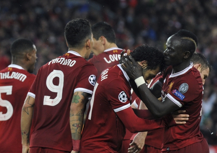 Liverpool's Mohamed Salah, second right, celebrates with teammates after scoring his side's second goal during the Champions League semifinal, first leg, soccer match between Liverpool and Roma at Anfield Stadium, Liverpool, England, Tuesday, April 24, 2018. (AP Photo/Rui Vieira)